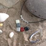 5 pebbles on black thong